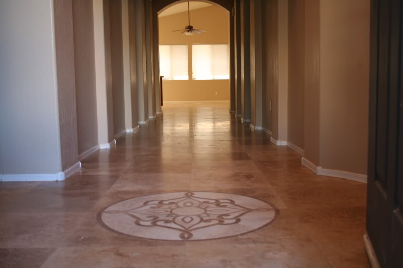 Travertine floor with round medallion